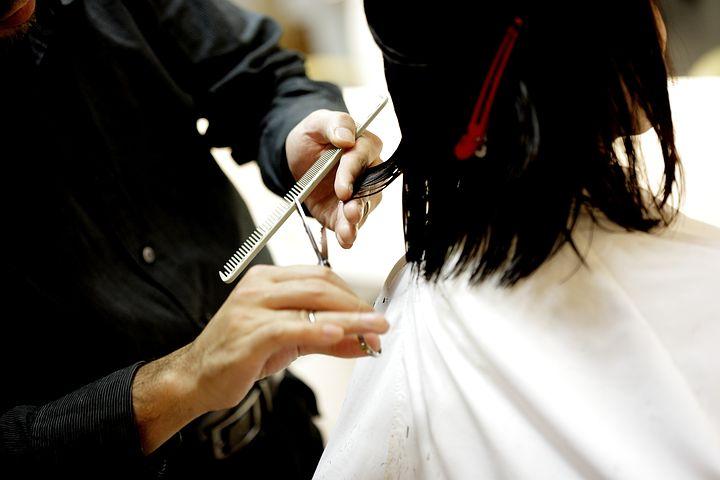 woman getting a haircut in a salon